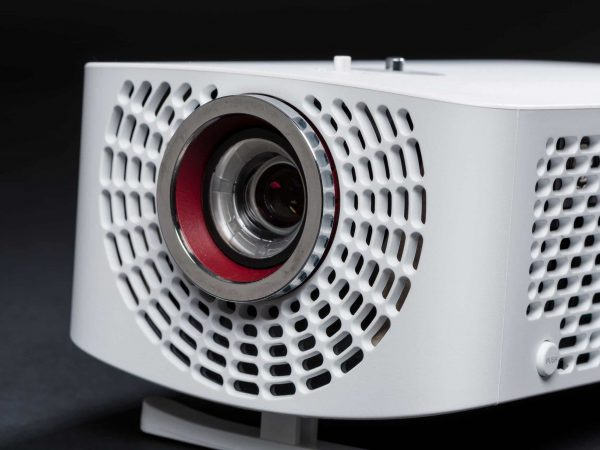 Stylish mini home cinema LED projector, lightweight tech gadget close up